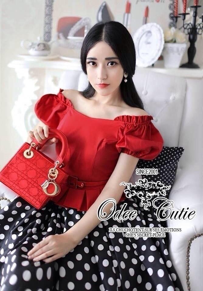 Celebrity style red blouse and polka dot skir