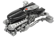 The V12 linked to hybrid system and transmission. (Image shows unpainted prototype; construction order differs)