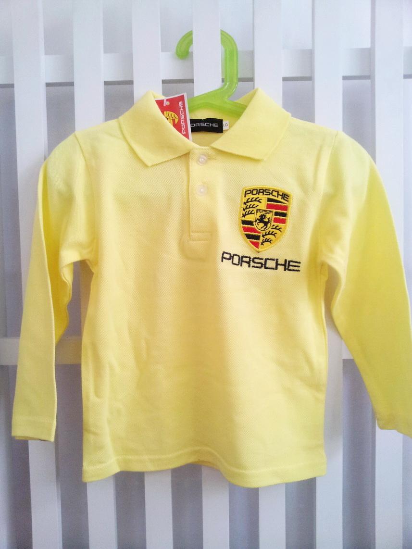 TX007 เสื้อโปโลเด็ก แขนยาว สีเหลือง เนื้อนิ่ม ใส่สบาย ปักตราสัญลักษณ์ PORSCHE ตรงอกและด้านหลัง Size 5/9/11