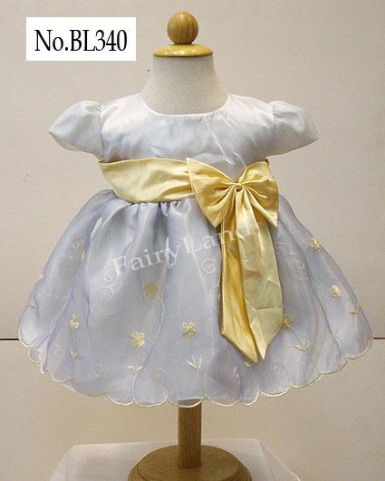 ชุดราตรีเด็กเล็กสีขาวปักลายเหลืองทอง